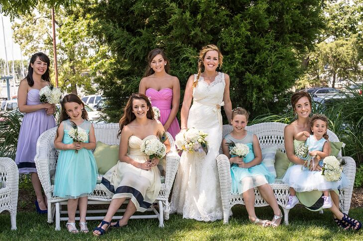 """My bridesmaids were all my younger sisters, so I wanted them to look their ages,"" Meagan says. ""I decided to let them each wear a different color."" Their W Too dresses featured bold navy stripes at the bottom of the skirt to tie in with the nautical theme. Meagan's flower girls wore aqua blue dresses."