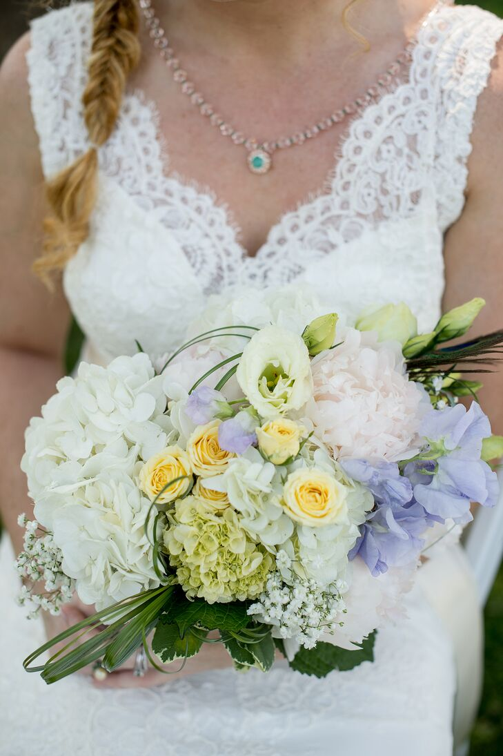 Meagan carried a bridal bouquet with white hydrangeas, blush peonies, viburnum and pale yellow spray roses. This pastel arrangement meshed well with the wedding's navy and white color palette. Floral design at the wedding was provided by Cache Fleur, a florist based out of Edgewater, Maryland.