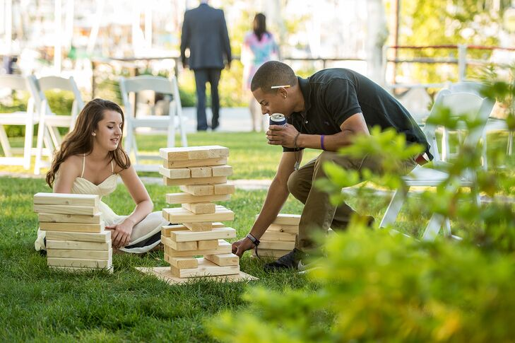"""Rich and I entertain a lot at our house. We have a big yard and play lots of yard games with friends. We wanted our wedding to feel like a big backyard party. During cocktail hour, corn hole, ladder golf and lawn Jenga were set up for our guests to enjoy."""