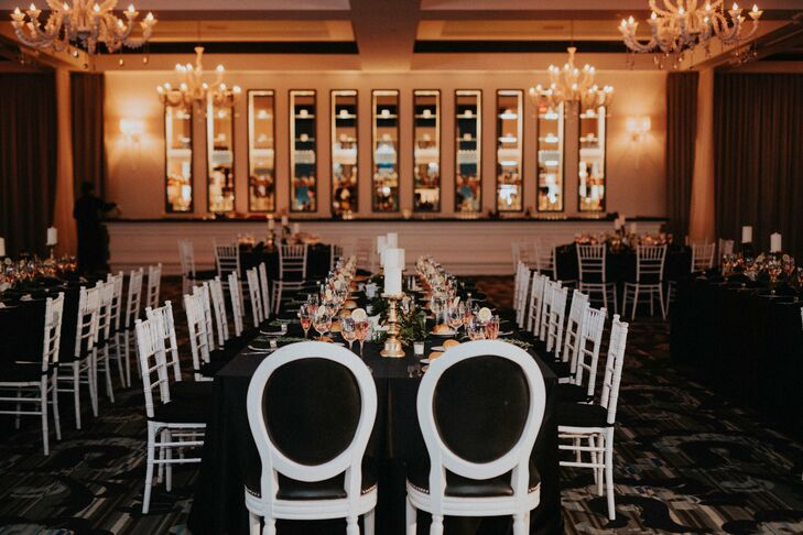 After cocktail hour, Anjali and Christophe ushered their guests into the ballroom for dinner and dancing. Warm candlelight, a dramatic black-and-white palette and gold accents gave the evening a romantic yet contemporary vibe, heightened by the addition of amber uplighting.