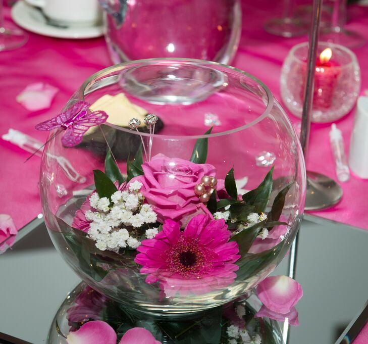 Pink Flowers In Fishbowl Vases
