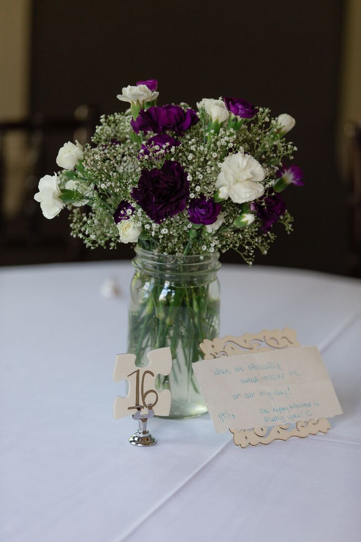 Puzzle piece table number with purple and white carnations