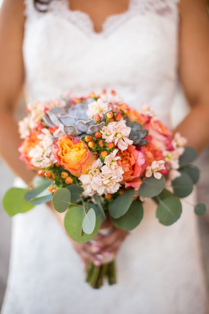 The peach bridal bouquet included succulents, roses, freesia, stock, hypericum berries and seeded eucalyptus.