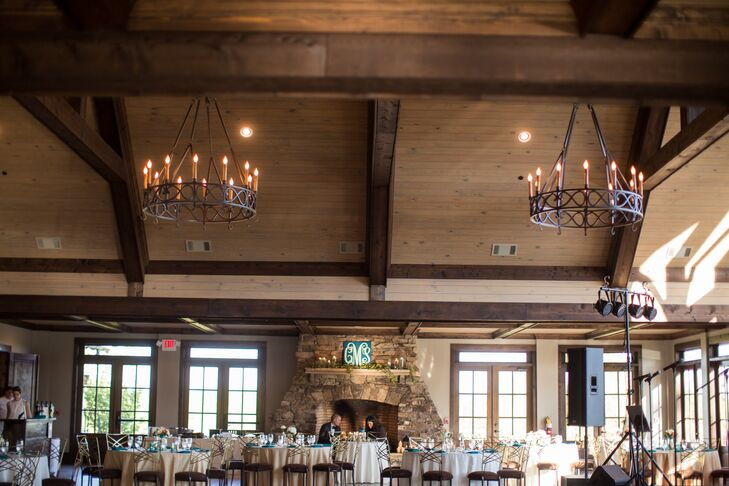 """We chose to have our wedding at Foxhall because the rustic timbers and stone venue is stunning!"" says Colleen. "" Legacy Lookout is a truly a spectacular venue with an indoor/outdoor fireplace and sweepingrnviews overlooking the Chattahoochee River and Legacy Lake!"""