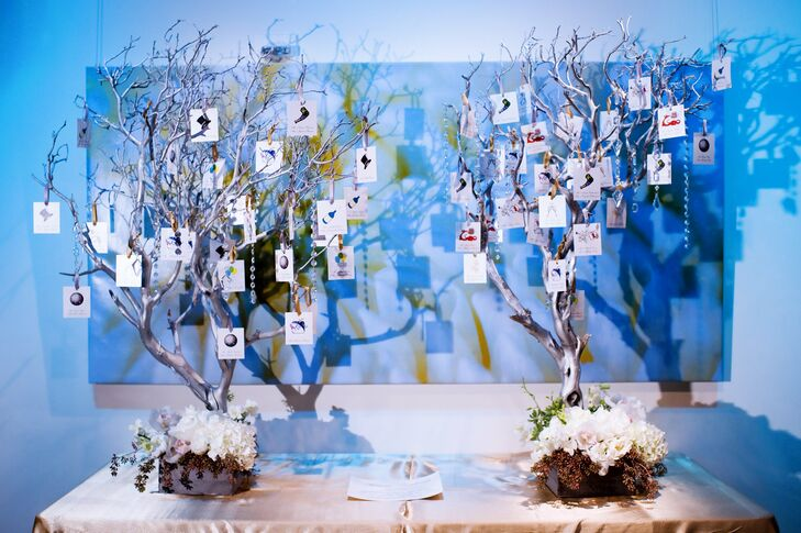 Silver-painted manzanita branches were strung with New Year's Eve-themed escort cards.