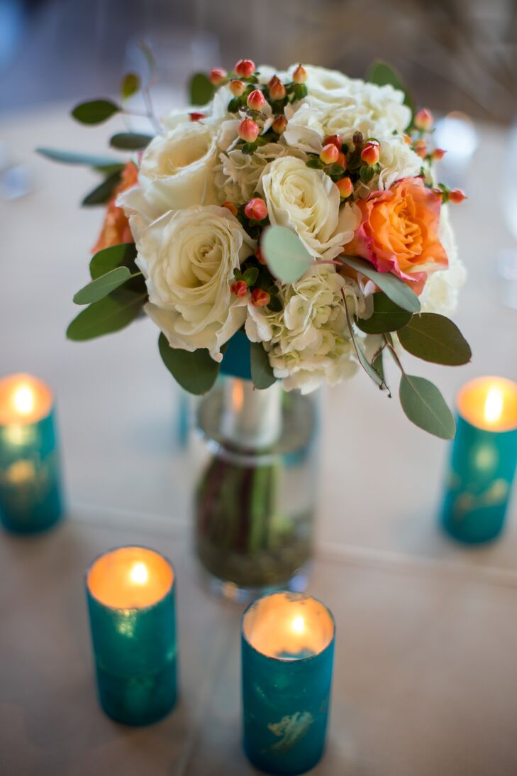 Peach and White Centerpieces Surrounded By Tea Lights