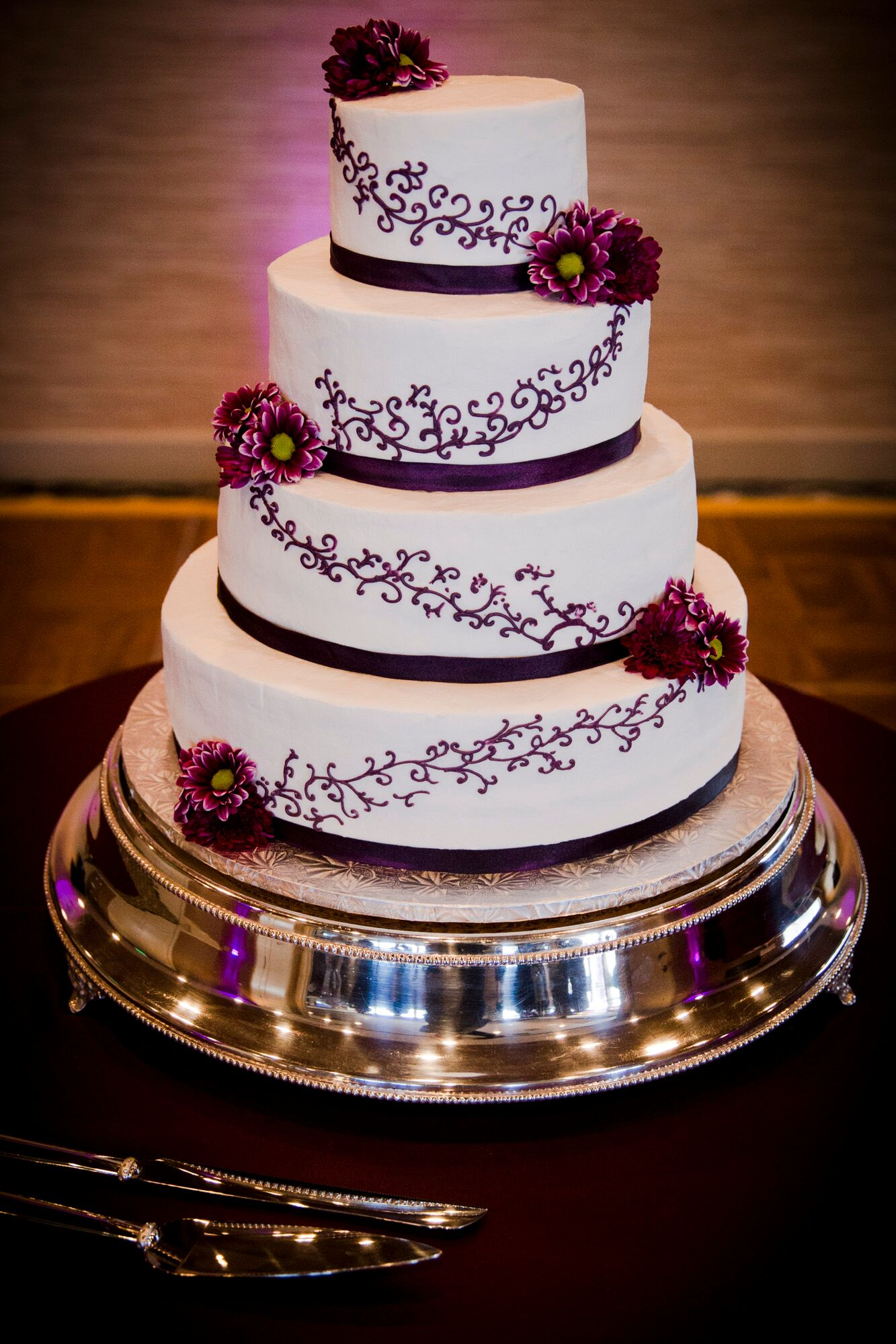 ivory wedding cake with purple roses ivory wedding cake with purple flowers 16552