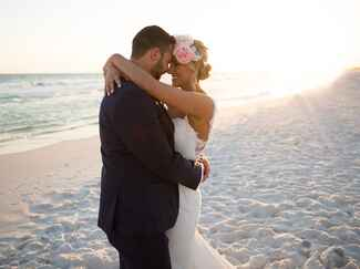 Bride and groom alone on the beach