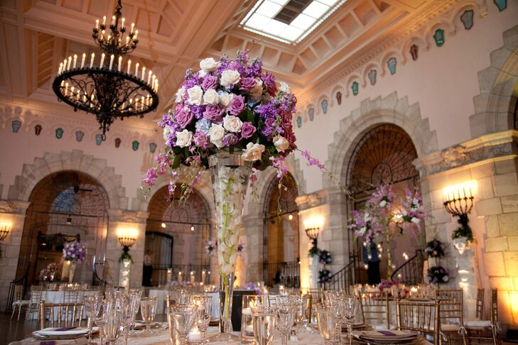 The couple decorated their reception with gold chiavari chairs, gold linens, gold accented chargers and three types of tall whimsical floral centerpieces.