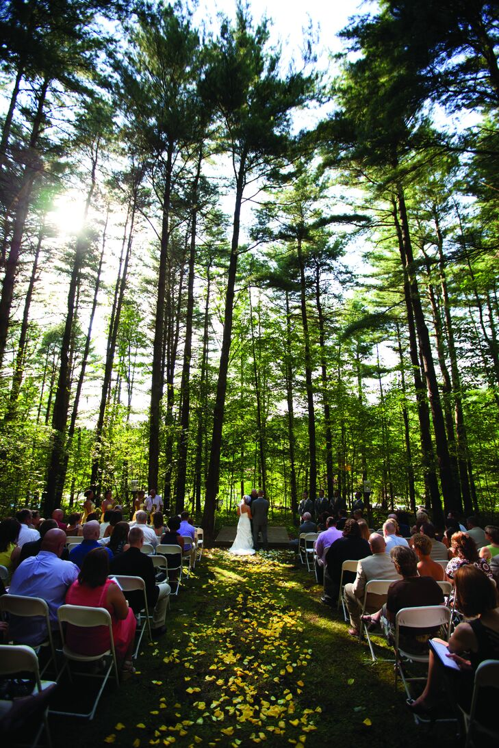 Amy and Eric wed in a romantic outdoor ceremony surrounded by tall trees.