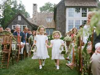 Flower girls in their dresses and basket