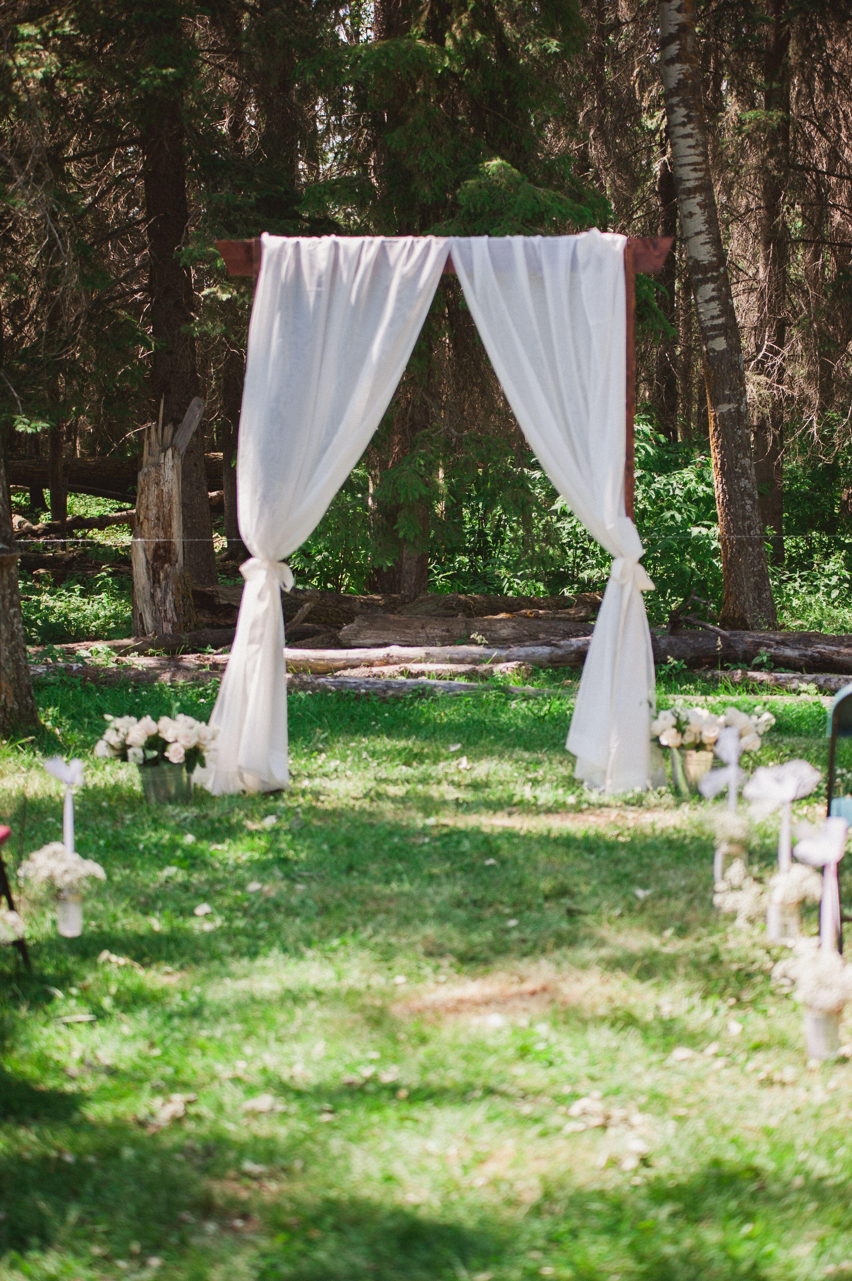 White Curtain Outdoor Wedding Arch