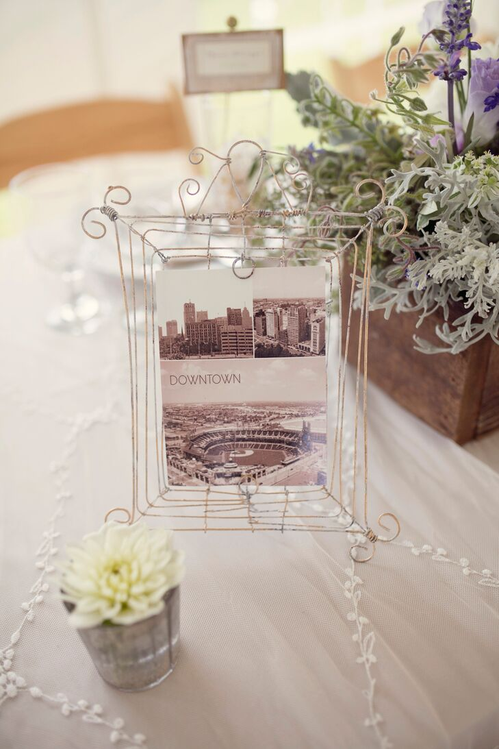 The table numbers where photographs of different Detroit neighborhoods in frames from BHDLN. For wedding favors, Heather's aunt meticulously hand painted a variety of champagne glasses.