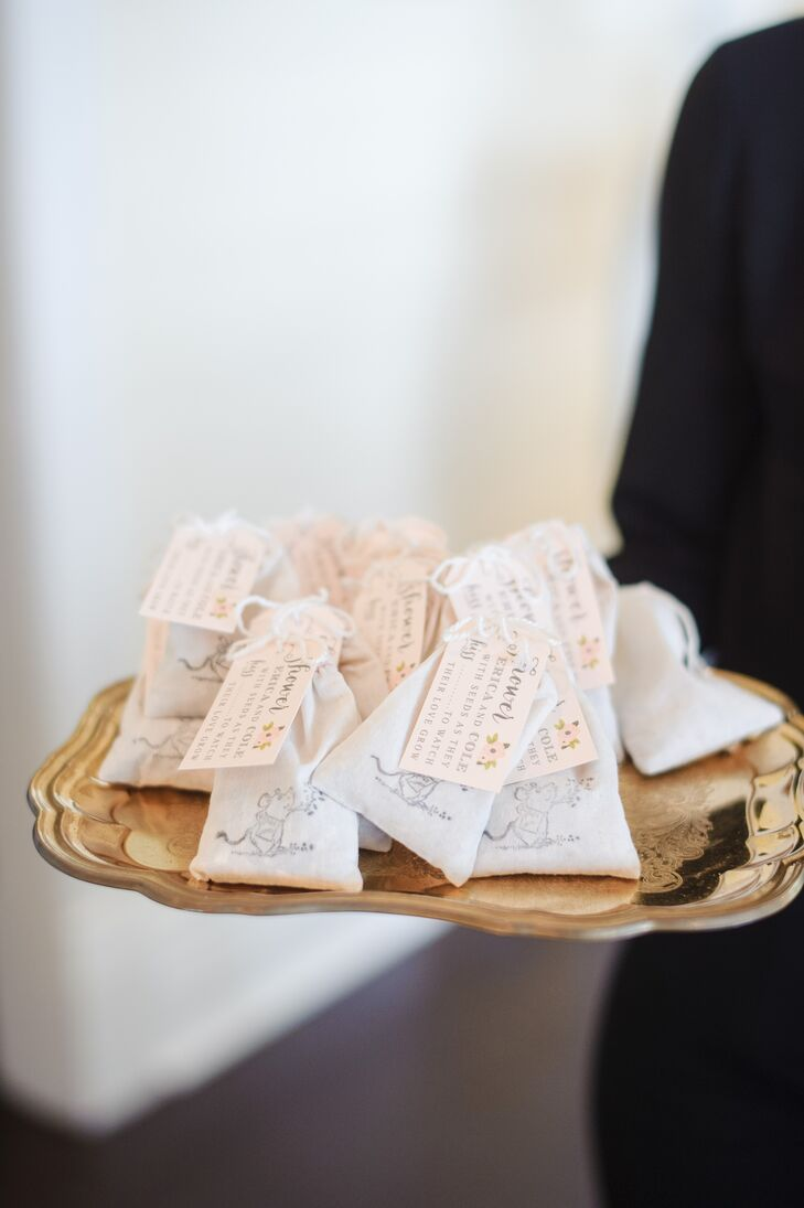 "Each of Erica and Cole's 119 guests was given seed packets with a small field mouse accent and personal tag as their wedding favor. ""We felt there was special symbolism in having a continual reminder of our wedding day and watching something ""grow"" from it,"" says Erica."