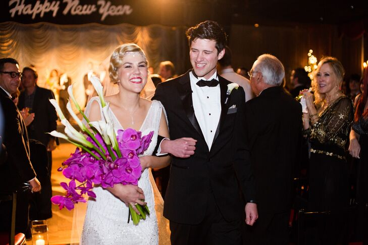 Groom and Bride Carrying Bouquet During Recessional