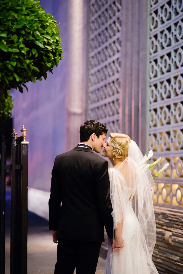 Bride and Groom Kissing Outside Venue