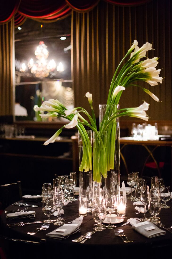 White long-stemmed calla lilies were arranged in glass vases and served as table centerpieces at the reception.