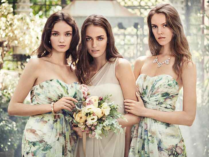 Women in floral print and solid bridesmaid dresses