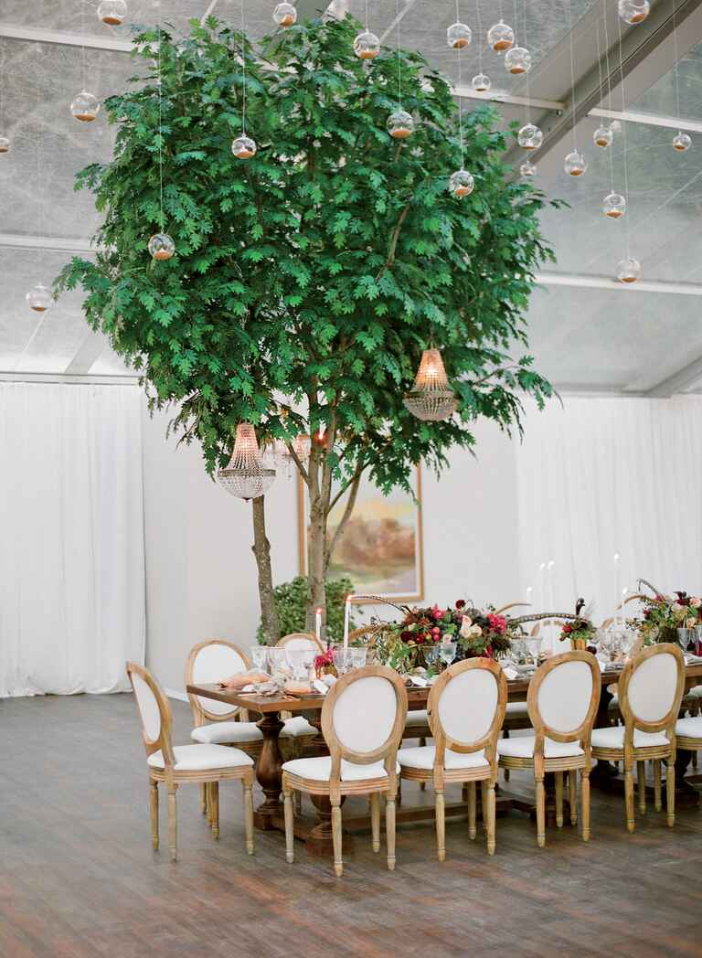 Indoor wedding reception space with suspended candles