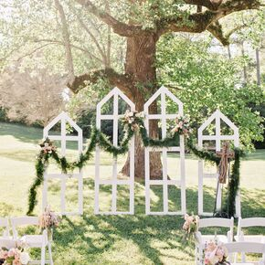 Trellis And Green Garland Ceremony Backdrop