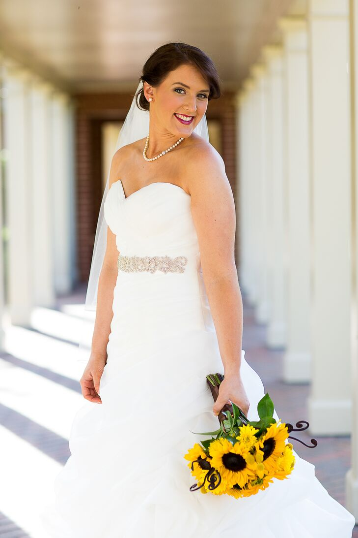Caitlin wore a strapless, A-line wedding dress with a sweetheart neckline and a rhinestone belt by Casablanca, which she purchased at the I Do, I Do! bridal store in Bethesda, Maryland.