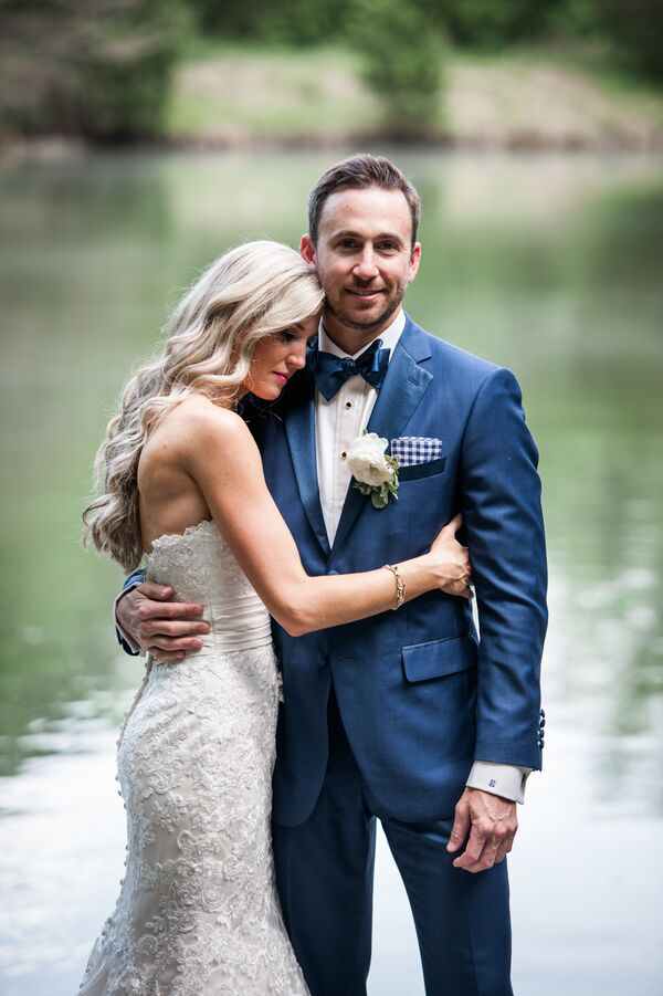 Lace Wedding Gown and Custom Navy Groom Suit