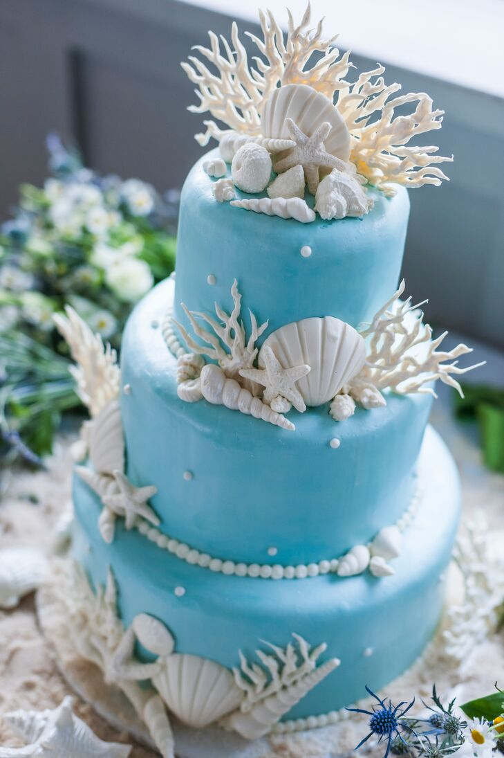 White Seashell And Coral Decorated Blue Wedding Cake