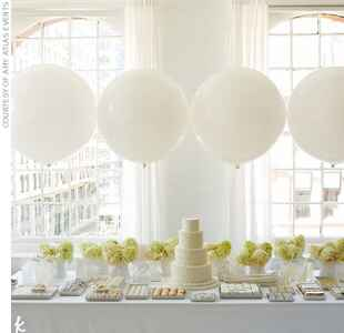 white wedding desserts and oversized balloons