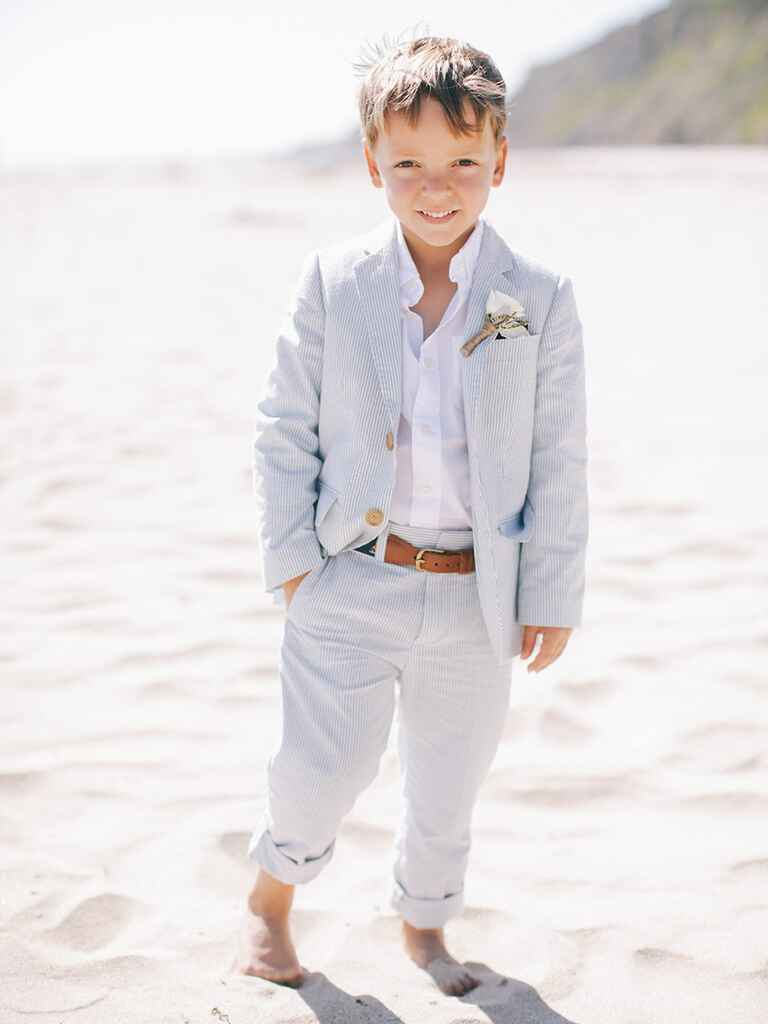Cute kid at wedding in suit