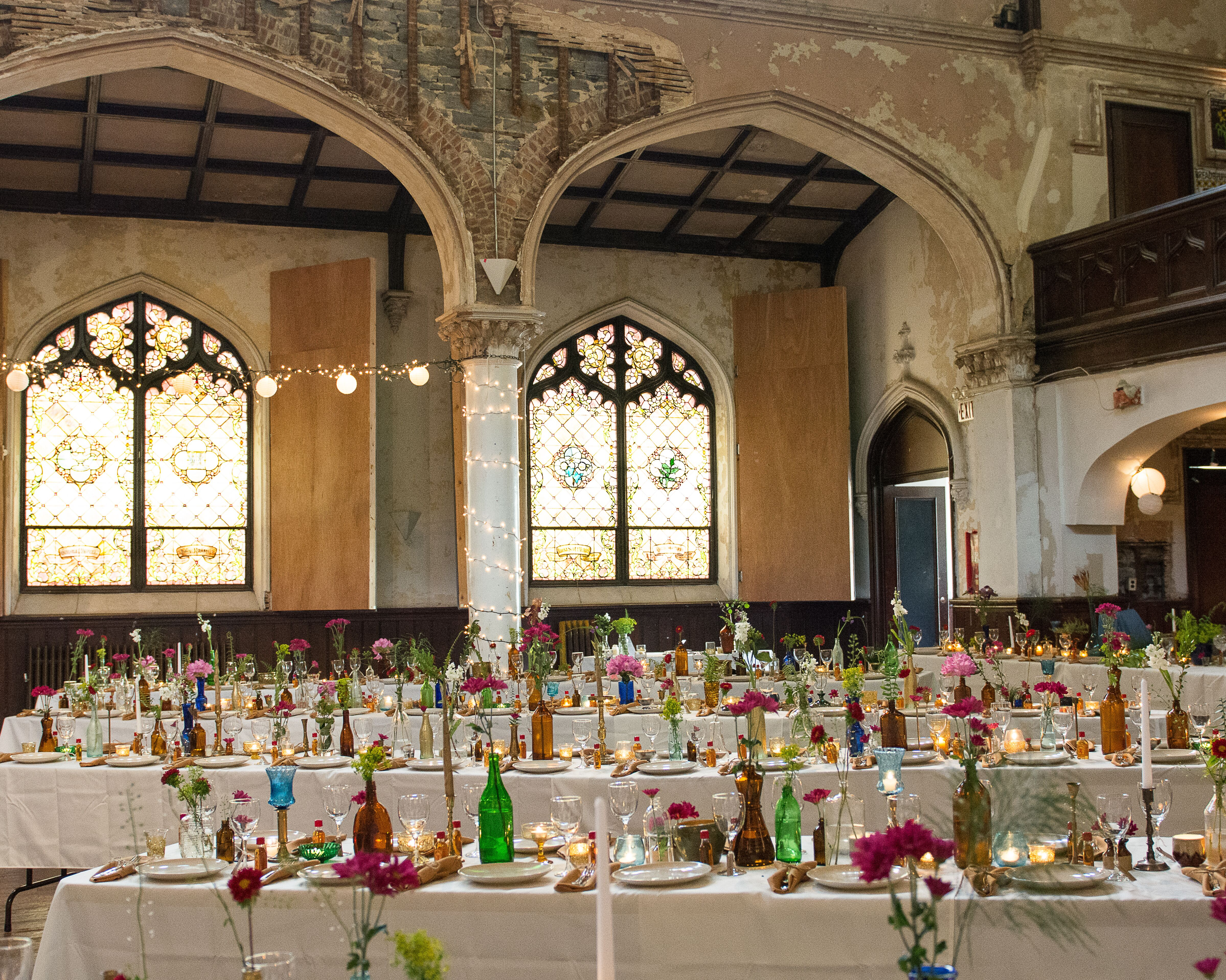 Long Tables With Mismatched Bottles As Centerpieces