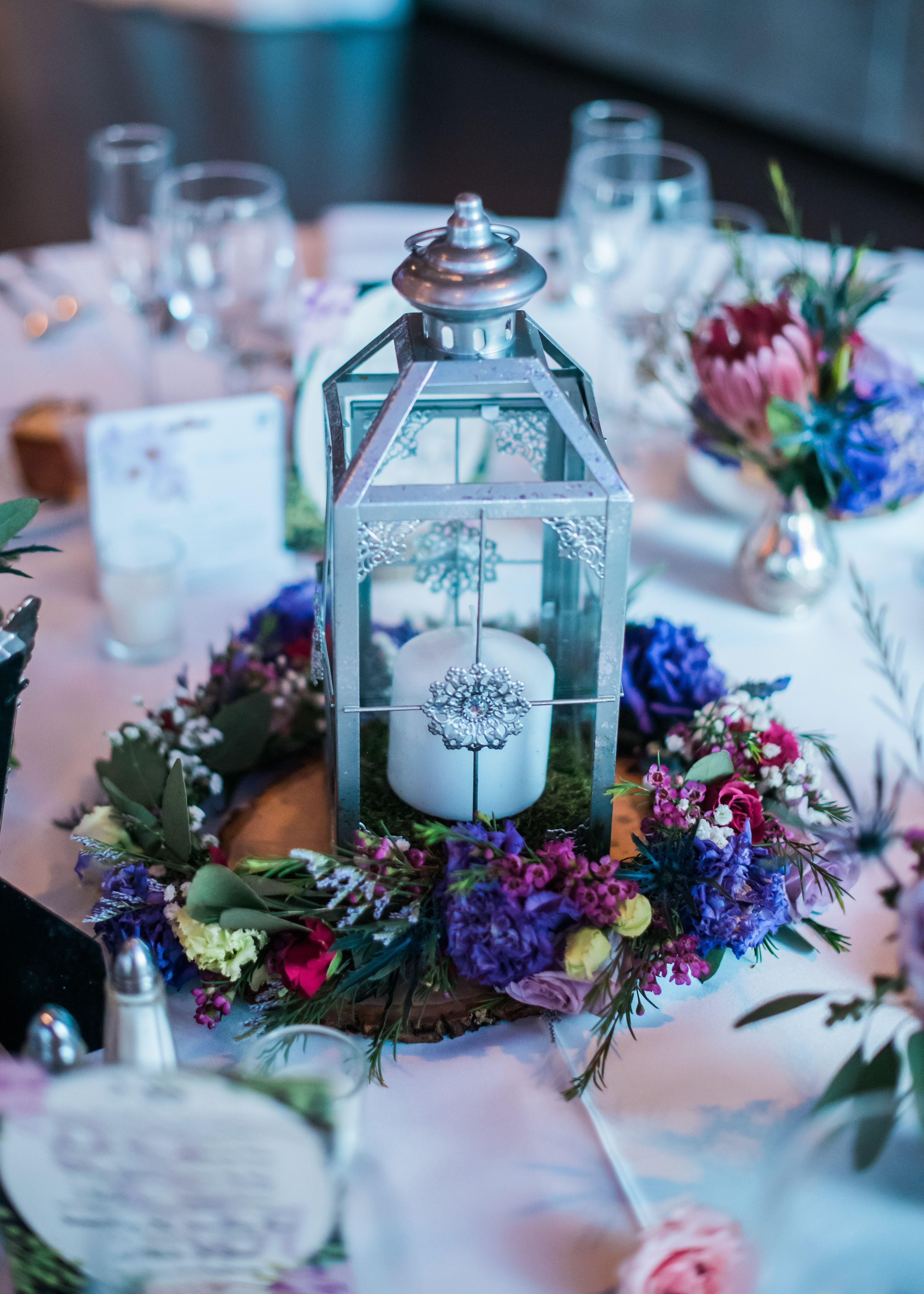 Silver lantern centerpiece with flower wreath