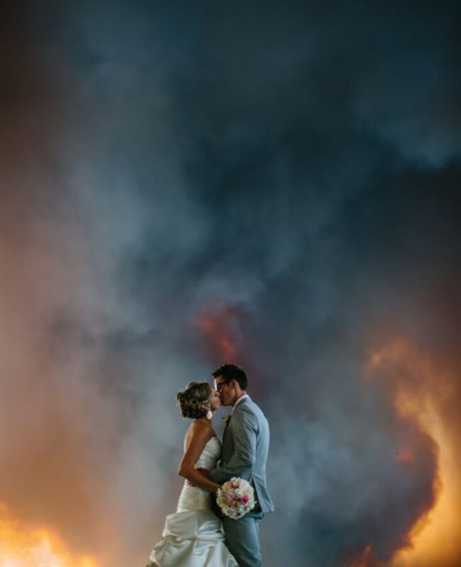 Couple in front of a wildfire
