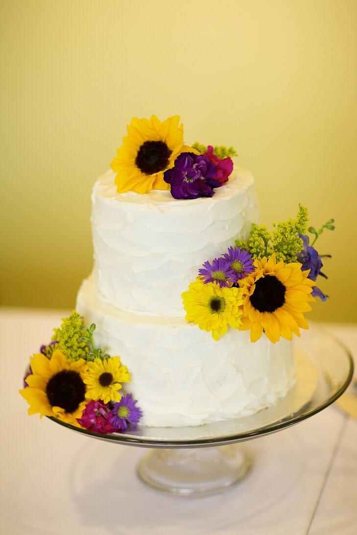 Yellow and Purple Flower-Decorated Wedding Cake