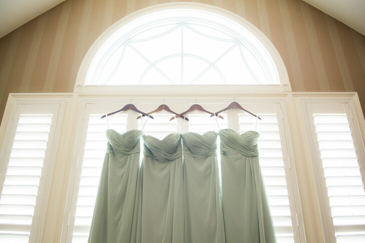 The bridesmaids wore strapless, sage green dresses with sweetheart necklines and draped bodices.