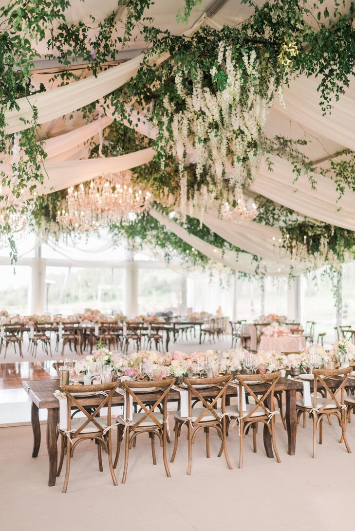 Reception Tent with Cascading Flowers, Draping and Crystal Chandeliers