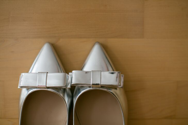 Instead of a traditional heel, the bride opted for metallic silver bow flats from J. Crew.