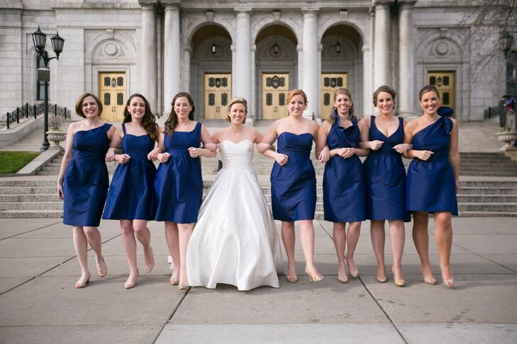 Each of Taylor's bridesmaids wore different variations on classic, navy LulaKate knee-length dresses.