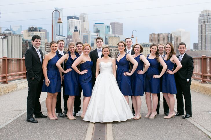 The bride's satin ivory gown popped against the navy LulaKate dresses she chose for her bridesmaids.
