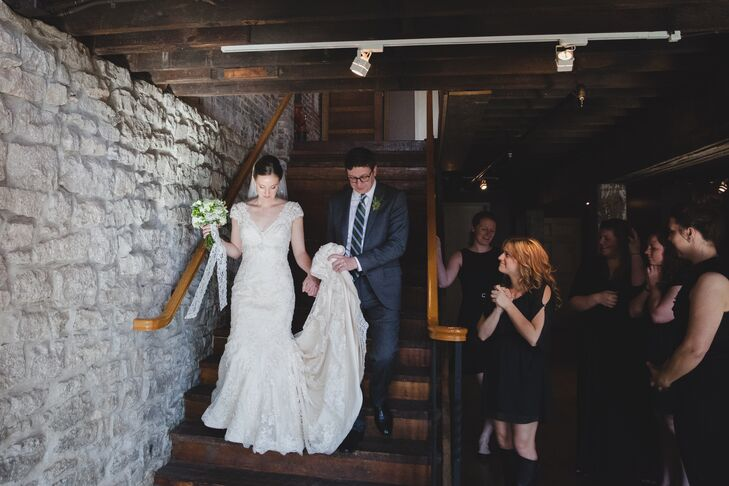 Kira wore a modified a-line lace wedding dress with a v-neck and cap sleeves.