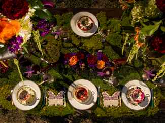 Mossy reception tablescape with jewel tone decor