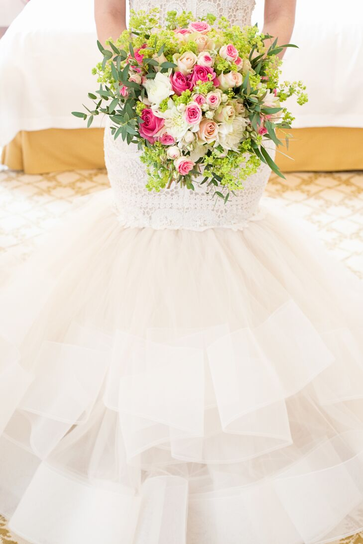 Amanda carried a bouquet with pink and blush roses, white chrysanthemums, viburnum and olive leaves.