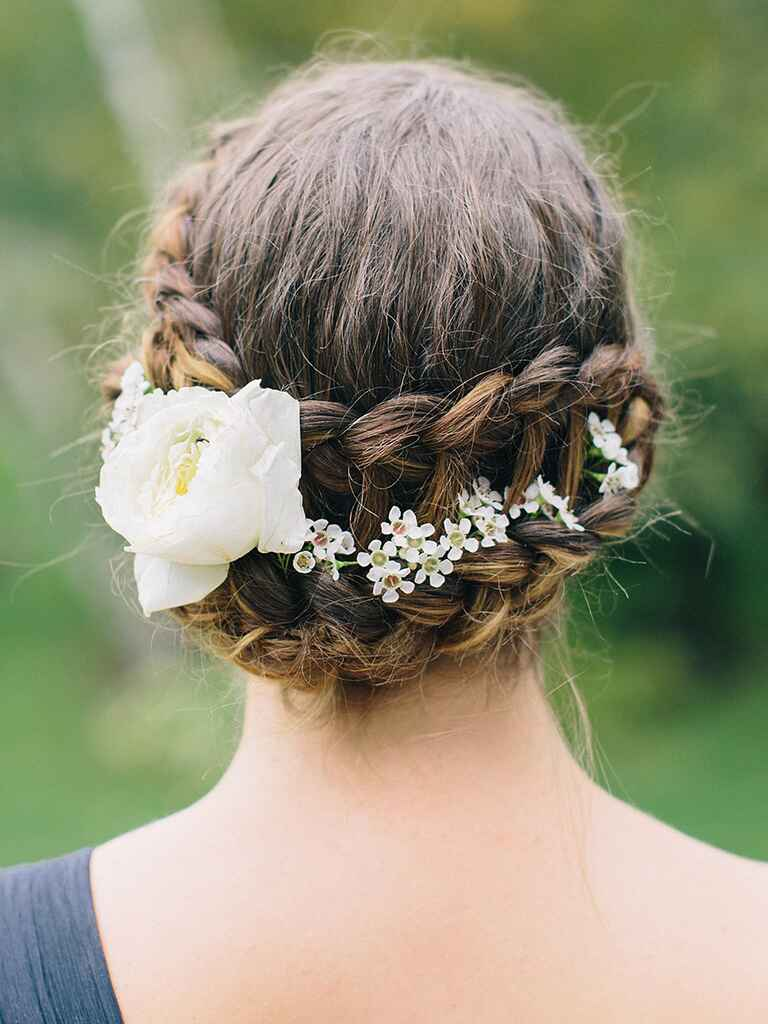 Dutch braid bridesmaid hairstyle with flowers