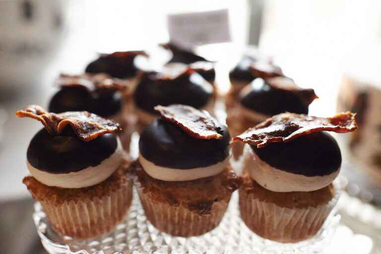 Cupcakes with chocolate icing and bacon
