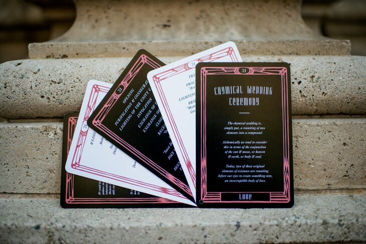 Lindsay's best man designed the invitations with a letterpress, which were gold and silver foiled with design elements scanned from old alchemical manuscripts. The invitation was enclosed in a laser-cut pattern that was inspired by the details on the chapel doors.