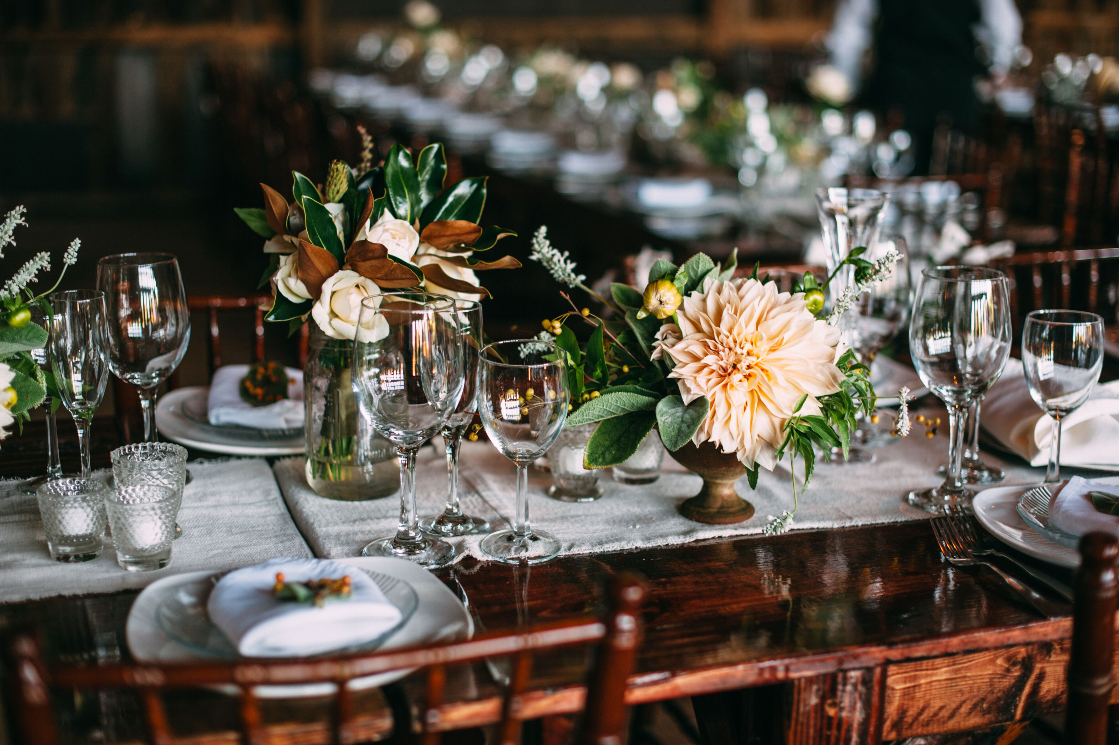 Centerpieces With Dinner Plate Dahlias Roses And Magnolia