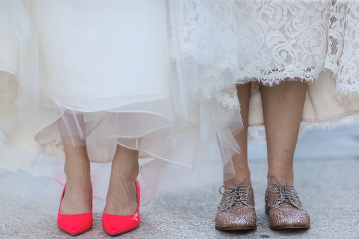 While Elana and Jamie chose different wedding day looks by different designers, they opted for one similar accent: Kate Spade wedding shoes. Each woman picked out a pair that fit her personal style. Elana opted for glitter-covered oxfords, while Jamie stepped beside her in bright, neon pink heels.