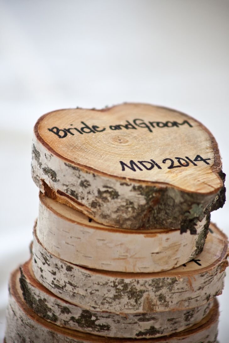 Owen cut birch rounds to be used as place cards for the tables. After the wedding, they served as favors for the guests.