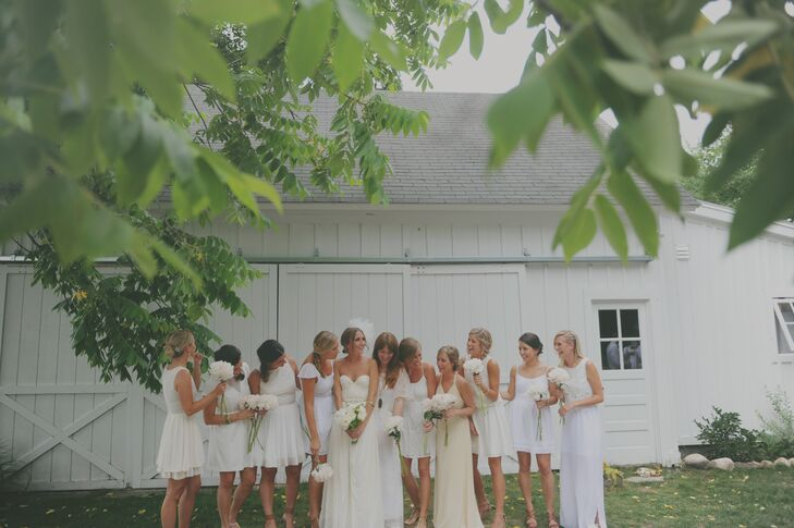 "Brittany let each of her bridesmaids choose their own neutral-colored dresses in either cream, tan or white. ""One girl wore a $12 dress and you couldn't even tell!"" she says."