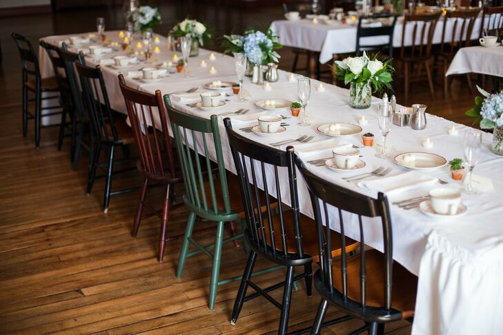 Colorful vintage chairs surrounded the white table decor for an eclectic, yet still pulled-together look.
