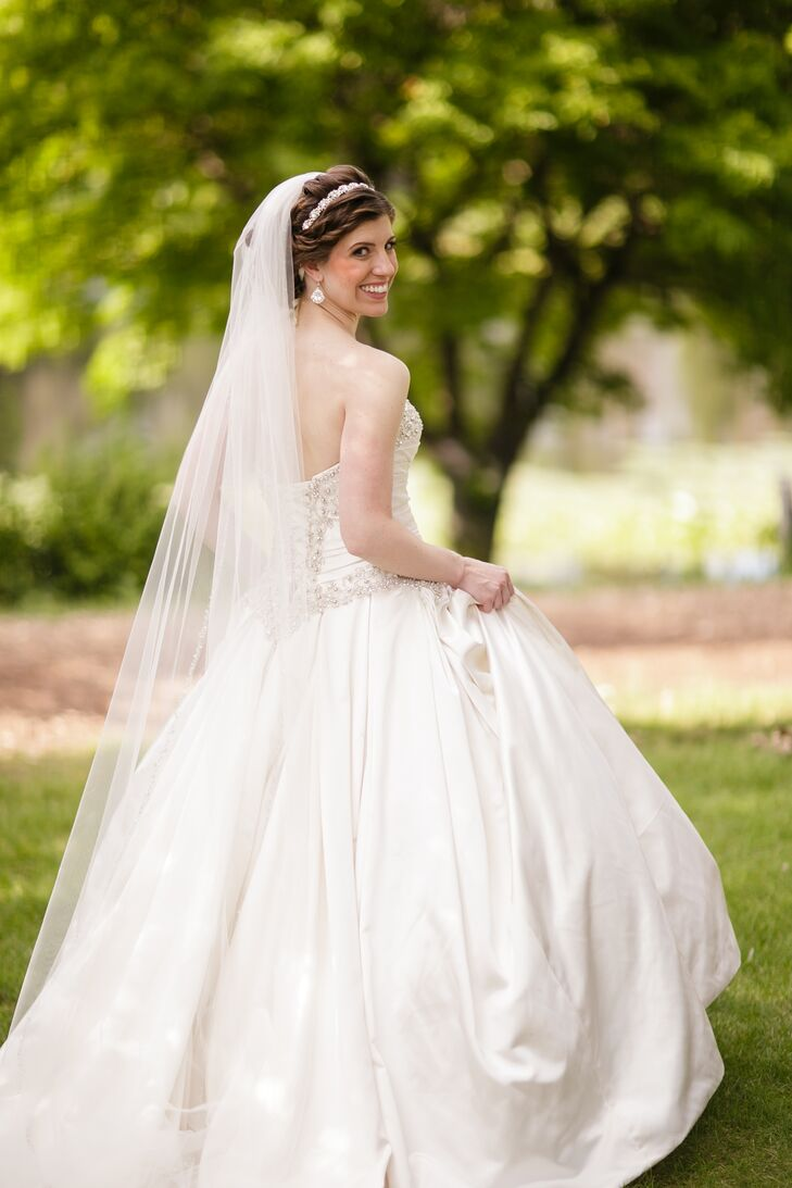The Bride\'s Princess Ballgown and Cathedral-Length Veil